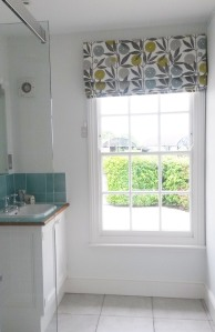 Scion fabric roman blind on rotary header rail - Dumbleton