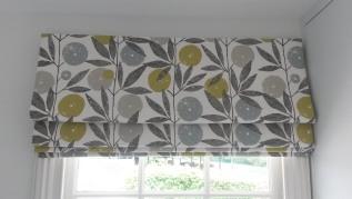 Scion fabric roman blind on rotary header rail - Dumbleton