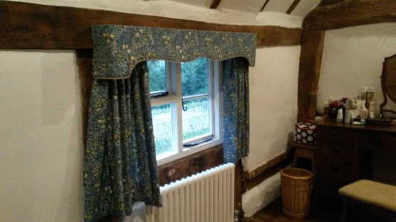 Cotswold cottage windows with traditional shaped pelmet