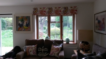 Roman blind on chain operated headrail - Baker Makasar fabric
