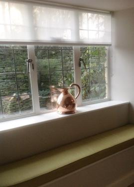 kitchen window seat cushion and Luxaflex sheer roller blind