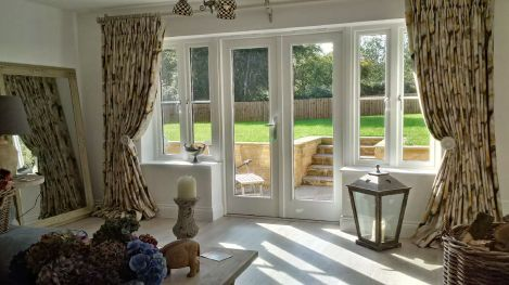 Extra wide windows with double pleat curtains in Zoffany Water Iris Gold/Charcoal, with Alison Davies Acanthus curtain pole and matching hold backs. Cheltenham, Gloucestershire.