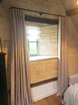 Inverted pleat linen curtains on 19mm diameter black French pole, with sheer linen roman blind. Cotswold Barn conversion near Cheltenham.