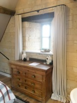 Inverted pleat linen curtains on 19mm diameter black French pole. Cotswold Barn conversion near Cheltenham.