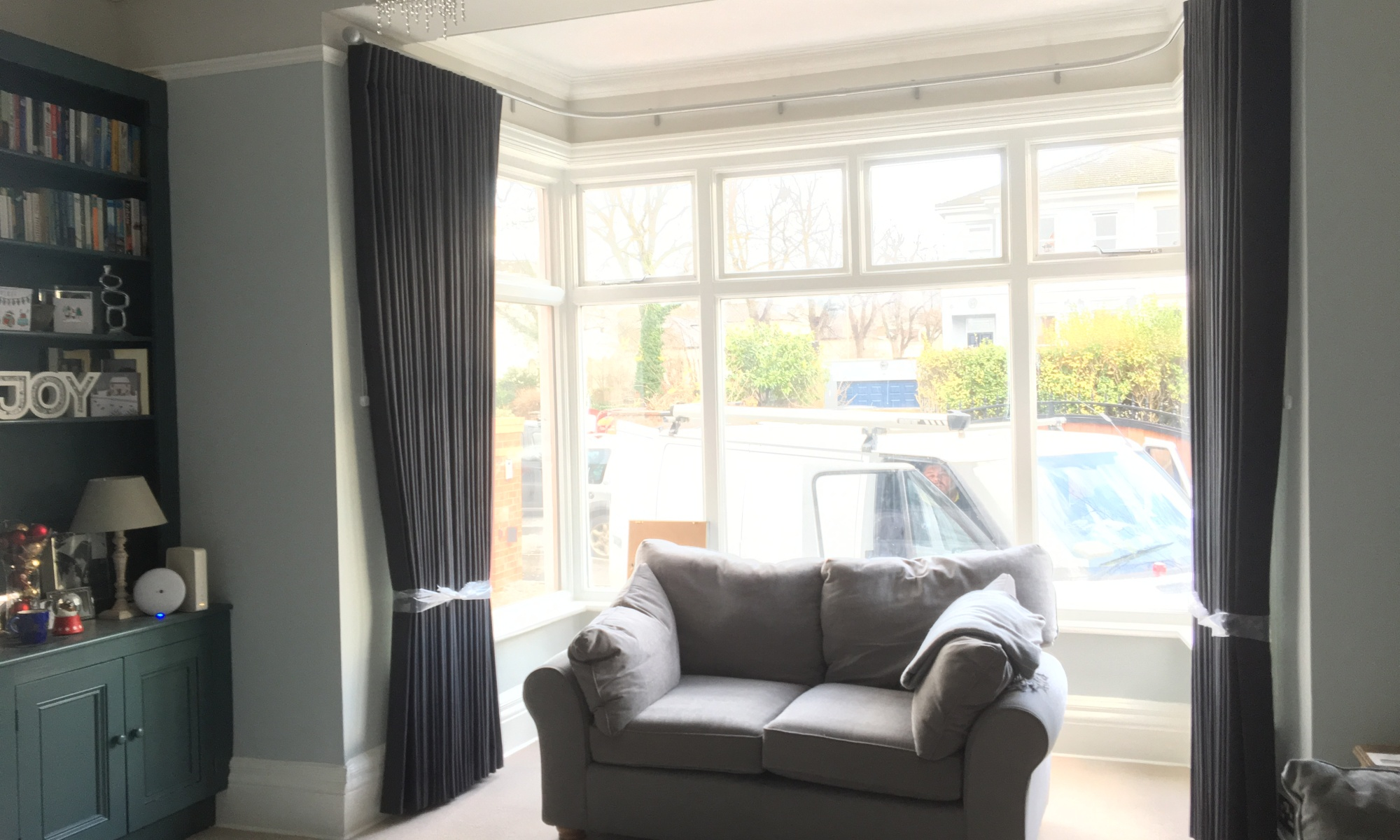 Cartridge pleat curtains on Silent Gliss Metropole in bay window - Cheltenham Town House